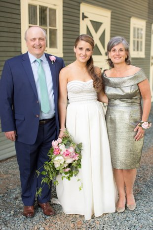 Kristina and her parents at the barn