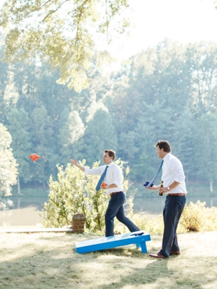 Groomsmen playing cornhole